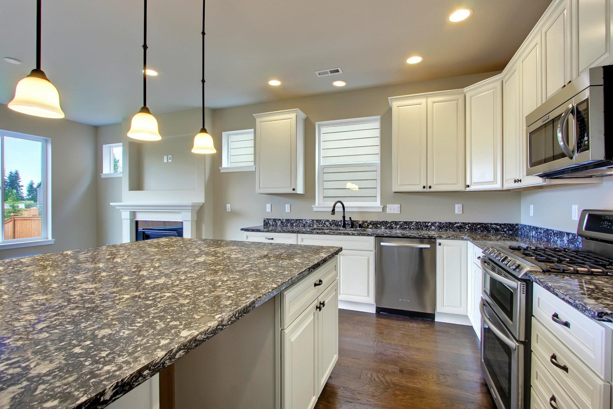 kitchen-white-cabinets-dark-countertops-photo-7