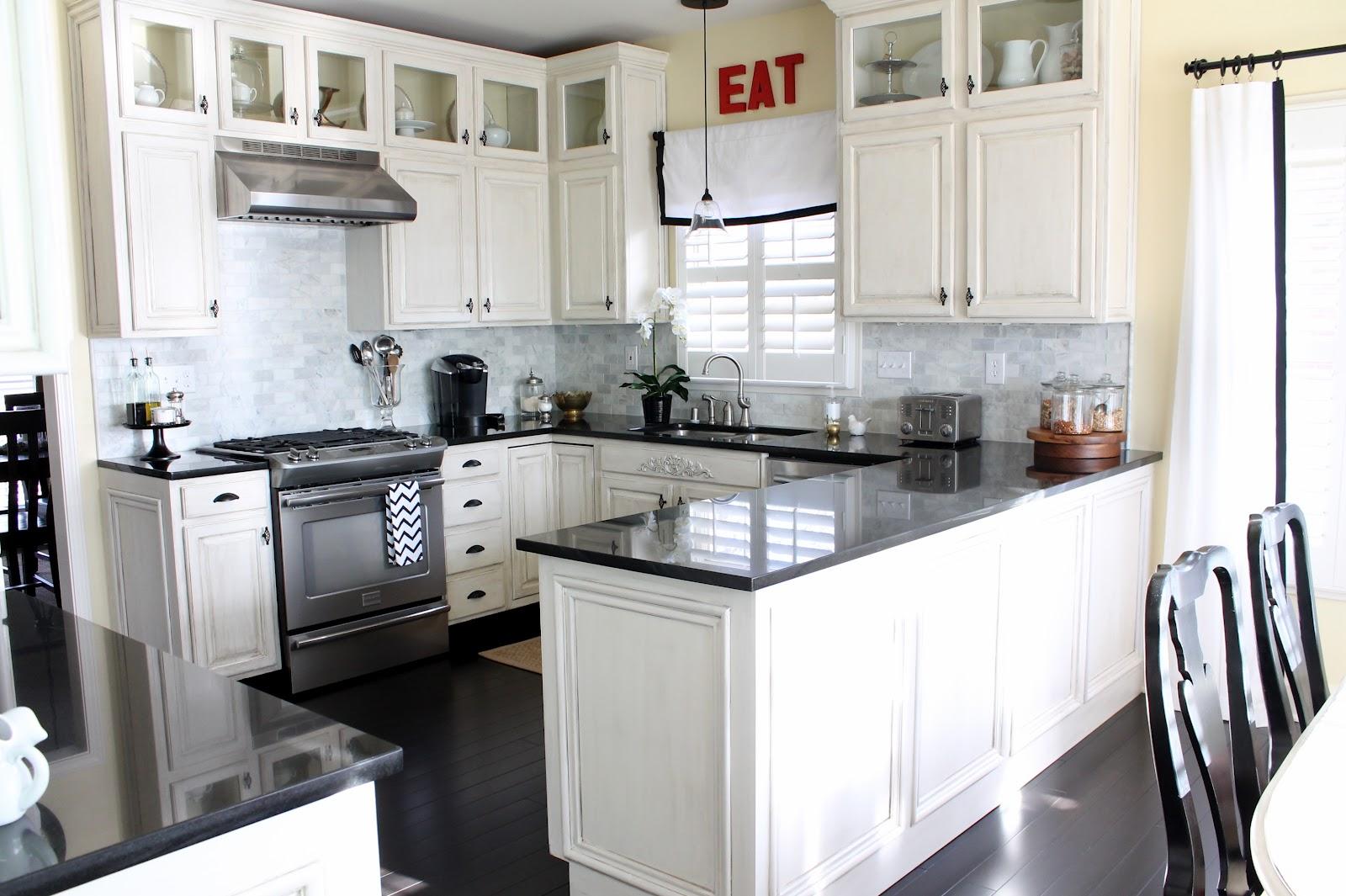 kitchen-white-cabinets-dark-countertops-photo-9