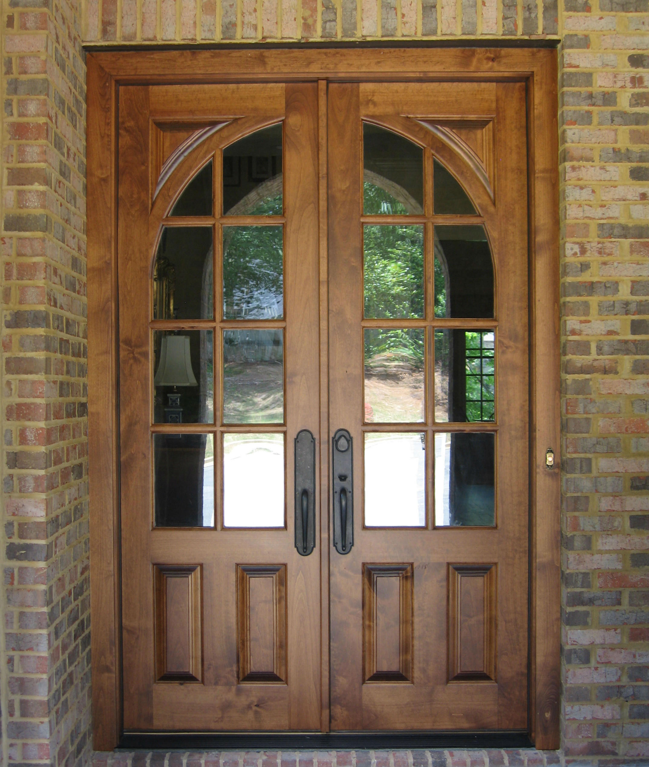 French country double entry doors give charming completions to the general appearance of your home