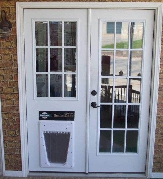 door with built in dog door photo - 2